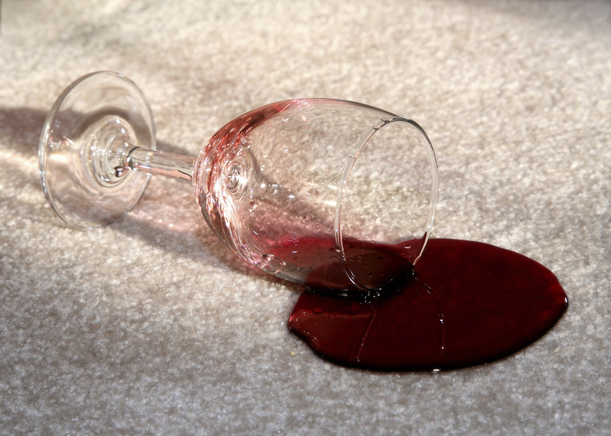 spilled glass of wine on a carpet