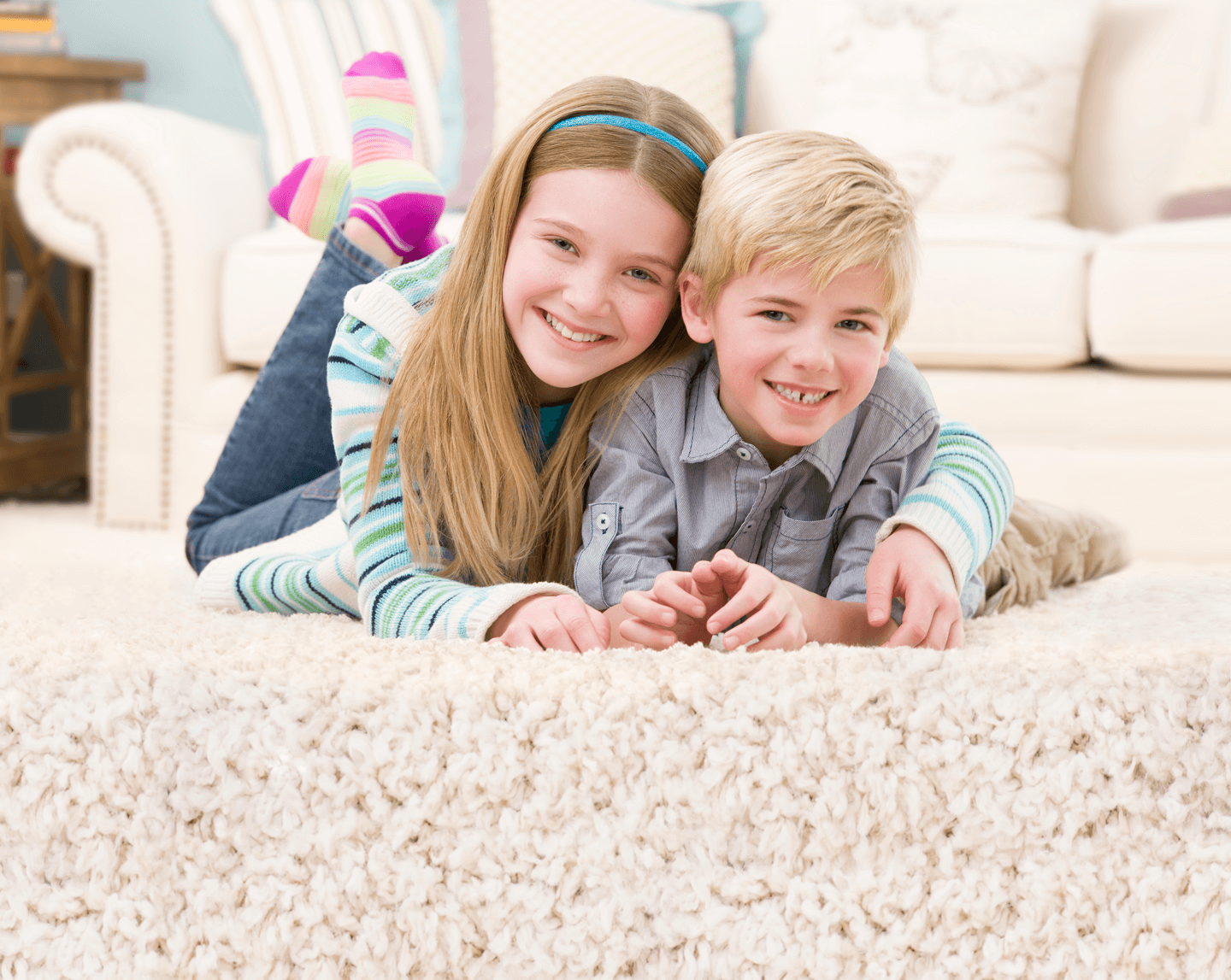 girl and boy laying on carpet together in reno nevada