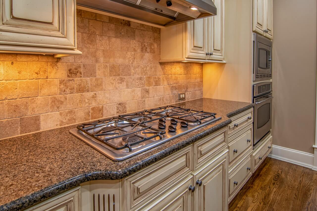 granite countertop with stove in kitchen